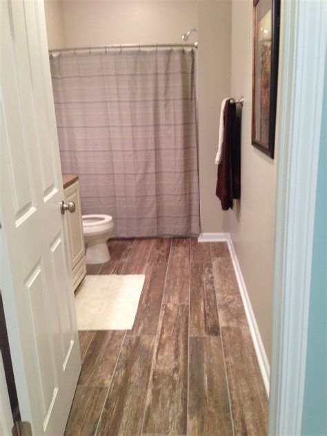 8 quot x 48 quot boardwalk coney island wood look porcelain tile full bath with vanity with granite top tile backsplash