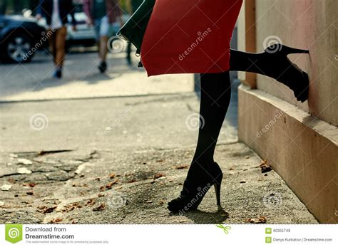 wearing black high heel shoes in city stock photo