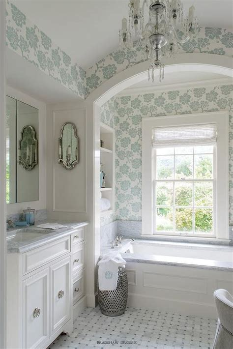 wainscoted tub  marble deck  arched alcove
