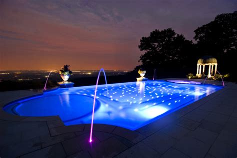night view of roman style swimming pool with deck jets custom swimming pool spa design ideas outdoor indoor nj