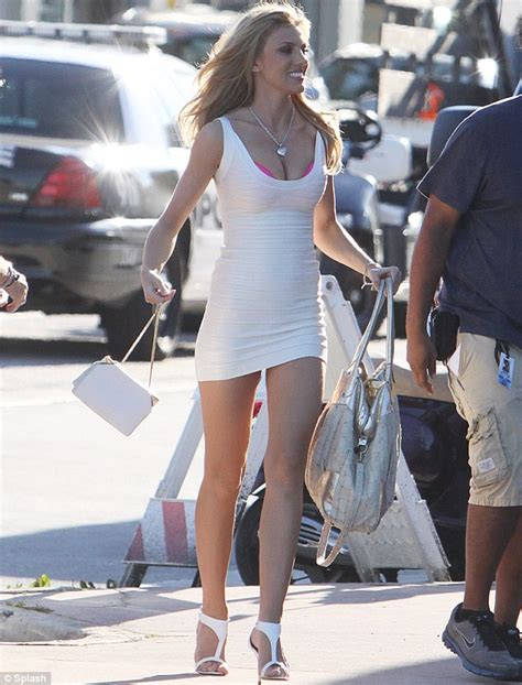 in character bar wore this skimpy white bandage dress which exposed