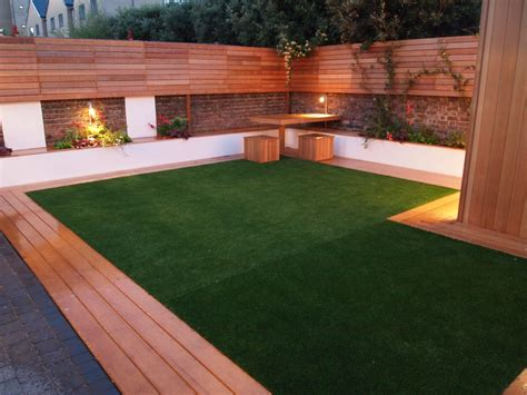 artificial grass and decking look great with good garden