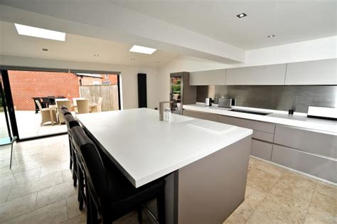 handleless kitchen with island breakast bar keller