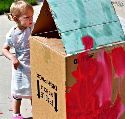 washable chalk paint diy painting a cardboard house with washable chalk paint for