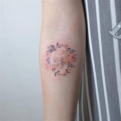 tattoo flower wreath illustrative skull and flower wreath tattoo on the right