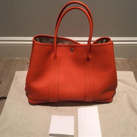 Lust Renton Orange Pouchbag hermes leather tote hermes ostrich birkin bag