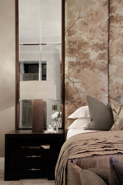 headboard with mirror and lights mirrors next to headboard to bring light sparkle into the
