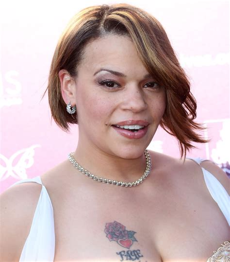 faith evans tattoo more pics of faith flower 1 of 7 faith