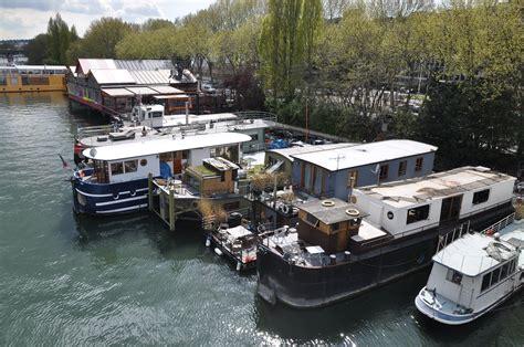 what is a house boat file houseboats on the seine river in saint cloud 002 jpg