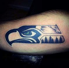 christian tattoo artists denver and this seahawks tattoo combining the logo with the