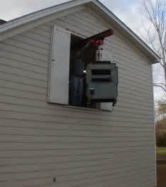 Garage With Loft Designs hoist installation