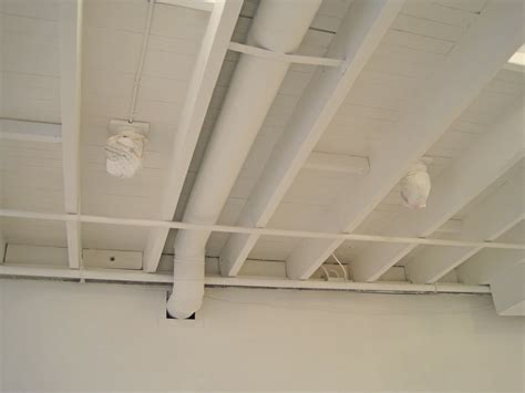 exposed basement ceiling interior design for shoes shop