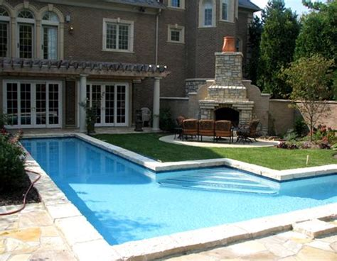 Backyards And Outdoor Spaces Summit International Flooring Backyard With A Pool