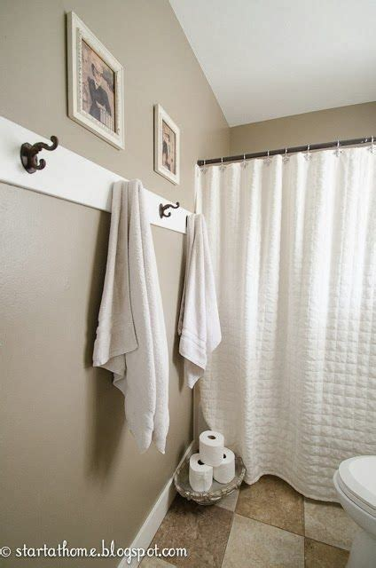 where to hang towels in small bathroom how to hang towels in bathroom