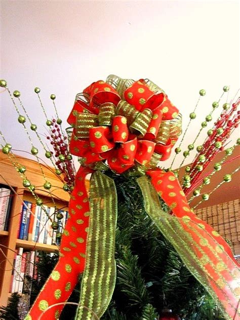 giant bow christmas tree topper in your choice of ribbon