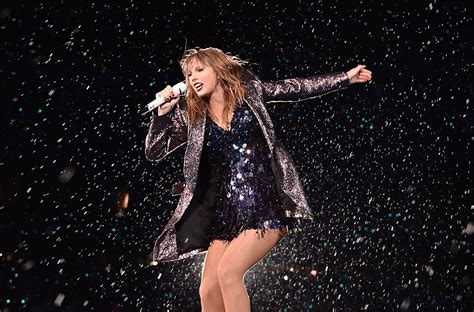 taylor swift tour photos taylor swift shares pride month message dances in rain at