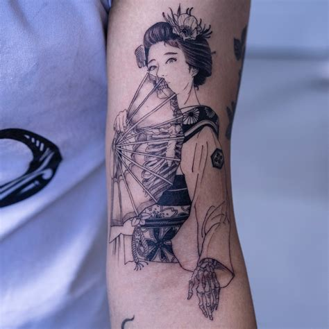 black tattoo artist black and white figural tattoos with a macabre twist by