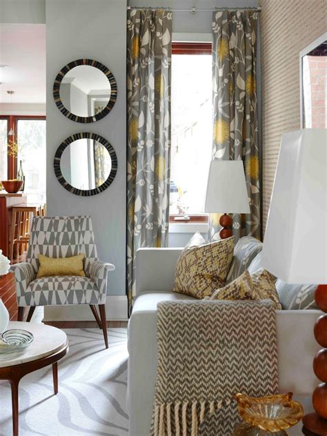 grey and yellow living room warm up the living room with plush throws if your blankets