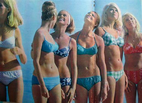 Depicting girls dressed in what looks like the modern day bikinis