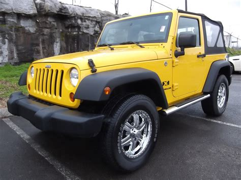 yellow jeep 4 door sold 2009 jeep wrangler x 4x4 2 door soft top yellow 3 6