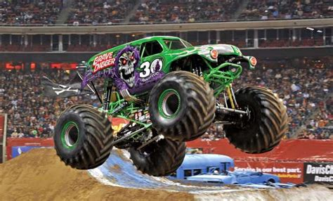 purple grave digger monster truck grave digger driver celebrates 30 years during a