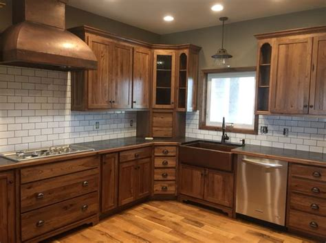 black stained kitchen cabinets white subway tile dark grout with stained hickory