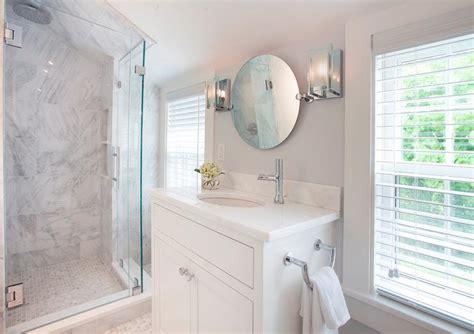 attic bathroom sloped ceiling white vanity with round pivot mirror cottage bathroom