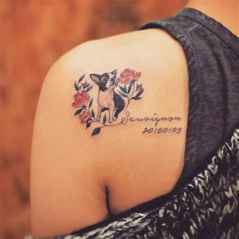 picture of dog with flowers and date tattoo