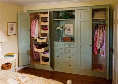 Closet Door Systems Do Away With Sliding Closet Doors Or Bi Fold Country Closet System From Crown Point Cabinetry