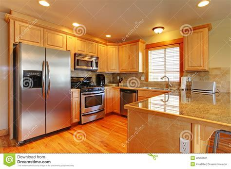 Golden Maple Beautiful Cabinets Kitchen. Stock Image