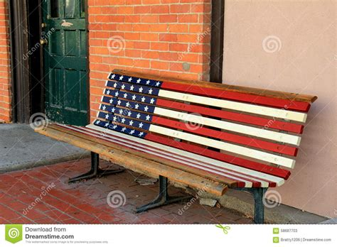 americana bench old weathered americana bench next to brick wall stock