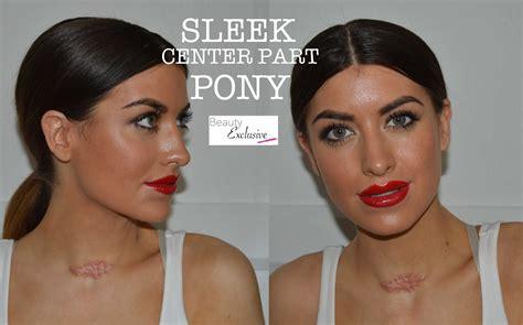 kim kardashians low sleek ponytail with center part celebrity get the sleek center part pony tail kim kardashian style