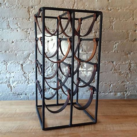 leather wine rack arthur umanoff wrought iron and leather strap wine rack at