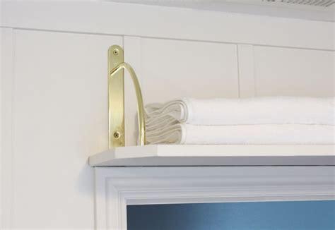 shelf over bathroom door diy above door shelf with gold brackets home decorating