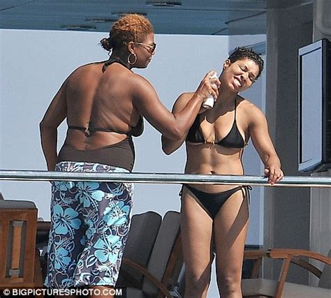 queen latifah shares a cuddle with her fitness trainer