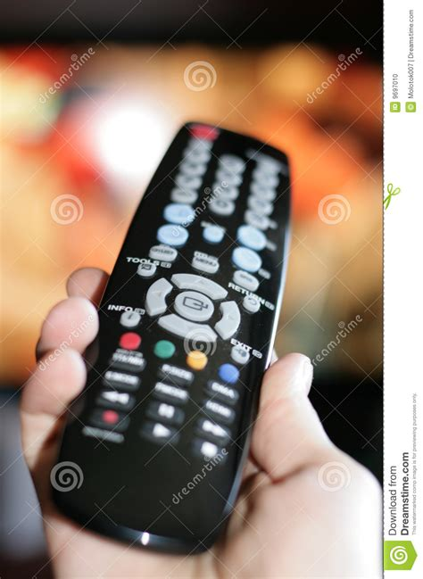 hand pointing  tv remote control stock photo image