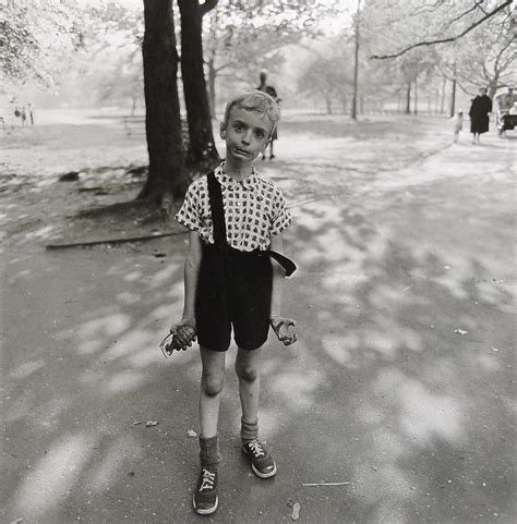triplets in their bedroom nj 1963 diane arbus child with a toy hand grenade in central park new york 1962 169
