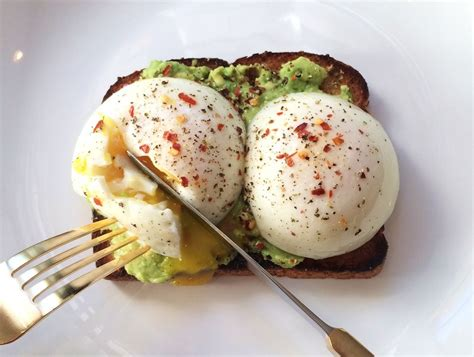 2 whole grain toast poached eggs and avocado on whole grain toast