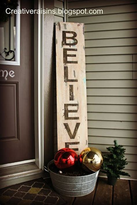 believe holiday decoration believe sign and galvanized with ornaments and greenery this for the front