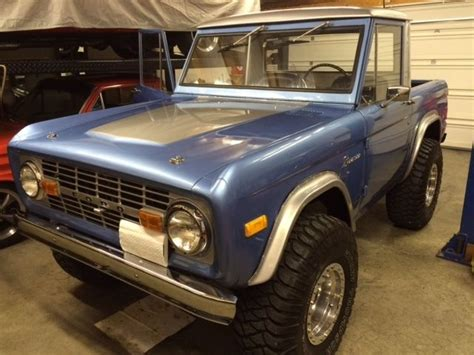 ford bronco rims 1977 blue ford bronco with half cab 35 quot mickey thompson