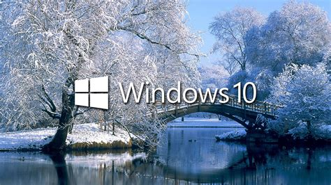 winter wallpaper for windows 10 windows 10 on the snowy lake white text logo wallpaper