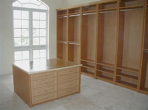 large closet in driftwood finish with drawer island unit