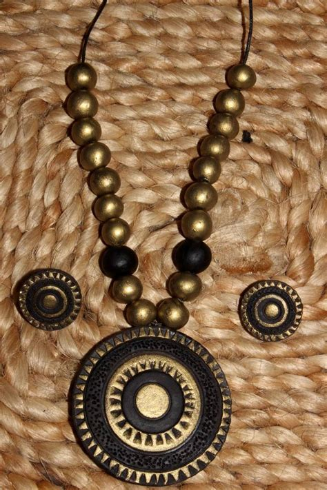 buy black and antique gold terracotta jewellery