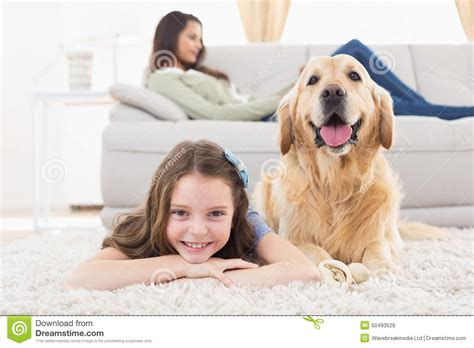 in rug and home commercial with lying on rug at home stock photo image 50493528