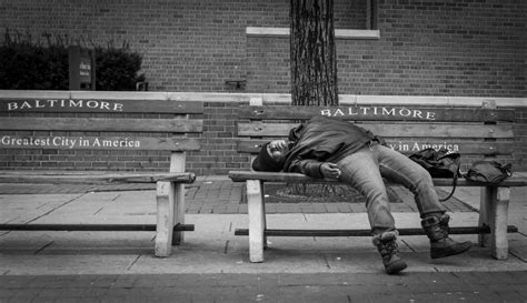 baltimore greatest city in america bench greatest city in america man passed out on bench