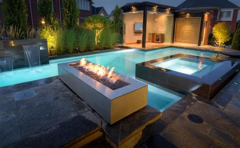 Contemporary Swimming Pool with Fire pit & exterior stone