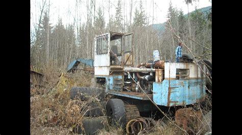 Alaska Car Dump Yard by Abandoned Logging Equipment