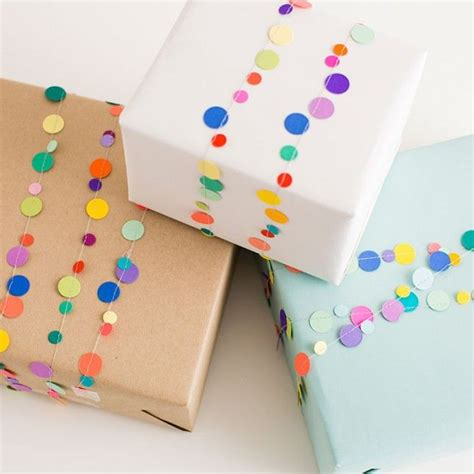 best way to wrap a gift 21 ways to upgrade your butcher paper gift wrap garlands
