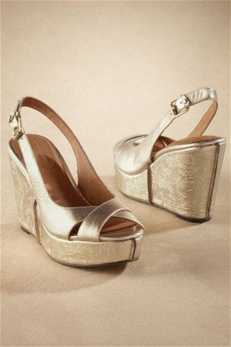 white and gold wedding reception shoes