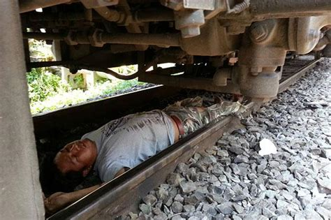 Suicidal man jumps in front of train, but survives ...
